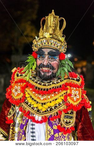 Ubud, Indonesia - August 8, 2016: Portrait of the balinese artist as an evil King Ravana in traditional Kecak Fire Dance ceremony in Hindu temple on Bali, Indonesia
