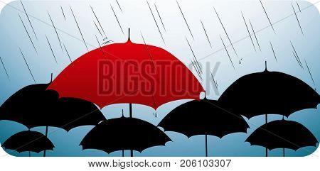 One red umbrella on top of many black umbrellas