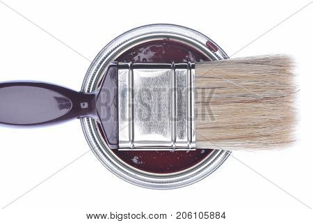Top view of cherry paint can with paintbrush isolated on white background