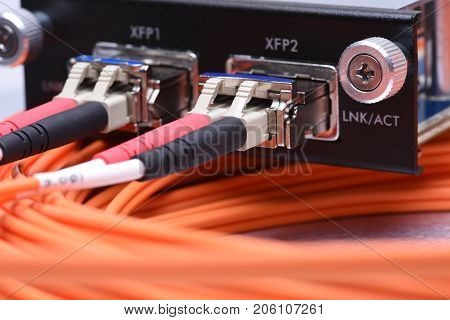 Network optical fiber cables connected to gigabit interface converter type XFP