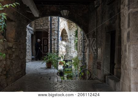 TOURRETTES-SUR-LOUP, FRANCE - APRIL 25, 2016: Street of Tourrettes-sur-Loup a medieval village in the Alpes-Maritimes department in southeastern France
