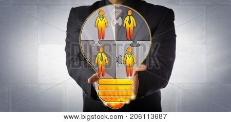 Unrecognizable businessman presenting an idea for building a work team. Human resources metaphor for teamwork staffing solution talent management knowledge pool and skilled workforce.