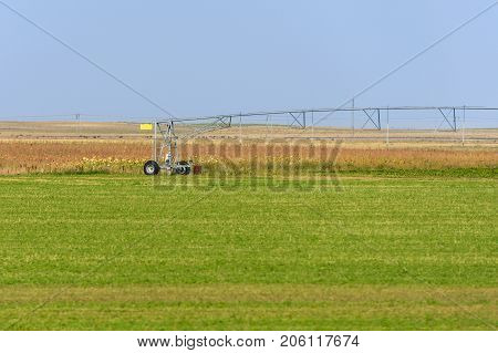 image of irrigation system on the green field