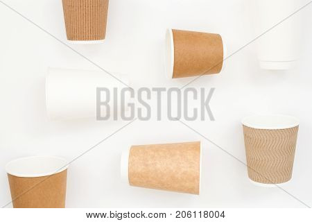 Disposable paper cups on white background. Geometry composition top view.