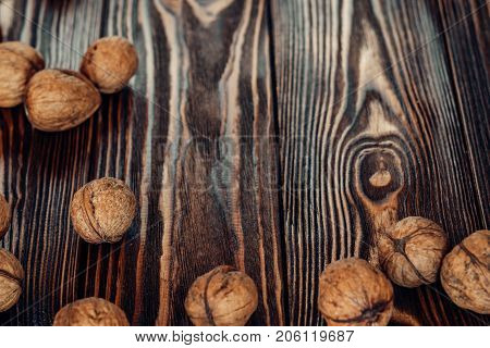 Dried nut is useful and natural on a wooden substrate. Appetizing