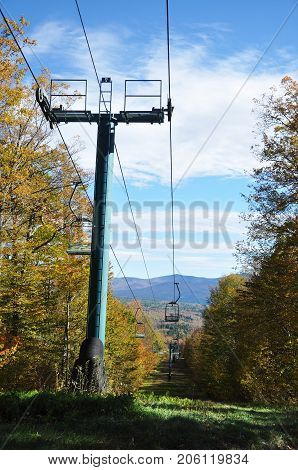 Fall Foliage and ski lift in forest on Mount Mansfield in Vermont, USA.