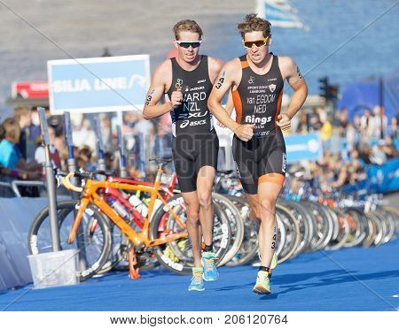 STOCKHOLM - AUG 26 2017: Running triathletes Van Egdom and Ward at the finish of the race in the Men's ITU World Triathlon series event August 26 2017 in Stockholm Sweden