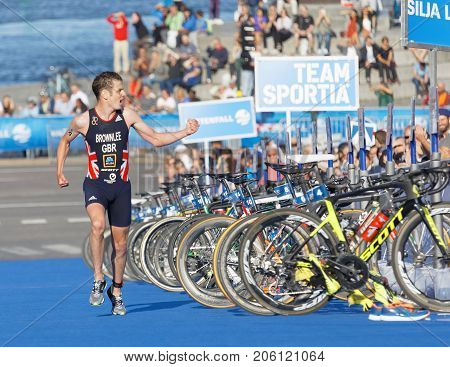 STOCKHOLM - AUG 26 2017: Running triathletes Jonathan Brownlee realize he is going to win the race in the Men's ITU World Triathlon series event August 26 2017 in Stockholm Sweden