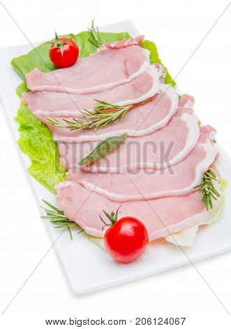 some pork loin slices on plate with salad
