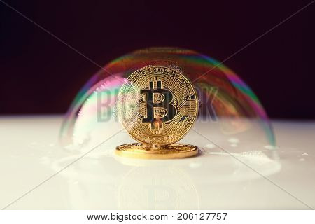 bitcoin. bitcoin in a soap bubble on black background