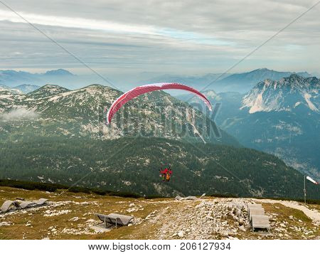 Paraglider Starting From Krippenstein On A Cloudy Day