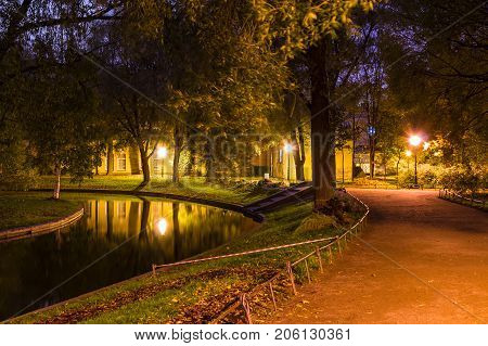 Night view of park footpath and pond in Yusupov Garden Saint Petersburg Russia