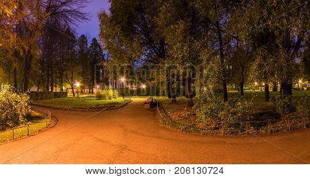 Panoramic night view of park and footpath in Yusupov Garden Saint Petersburg Russia
