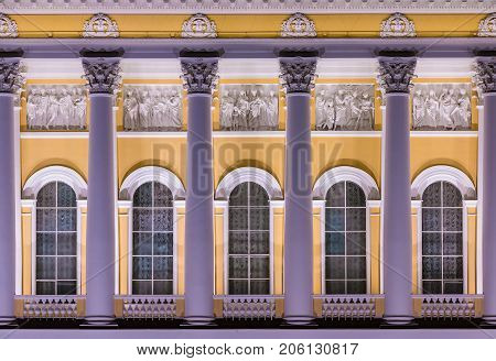 St. Petersburg Russia - October 19 2016: Several windows and columns in a row on night illuminated facade of State Russian Museum front view