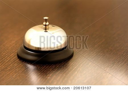 vintage brass bell on hotel bellstand