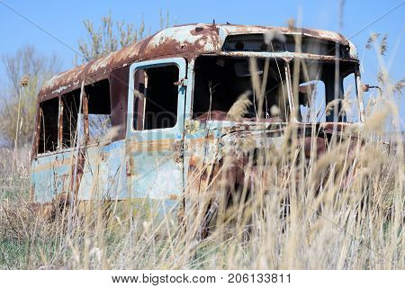 ARARAT PROVINCE, ARMENIA - APRIL 4: Old and abandoned Soviet Russian bus in the middle of reeds April 4, 2017 in Ararat Province, Armenia.