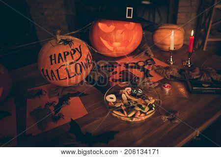 High Angle Shot Of Cutted Pumpkin, Fall Leaves, Spider Web Net, Skull, Cap Of Witch, Bowl With Sweet