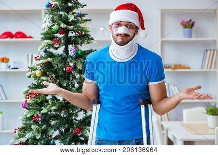 Injured man celebrating christmas at home