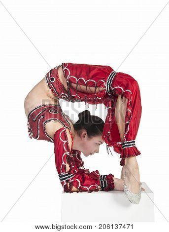 A Young Contortionist,circus Performer In A Red Suit.