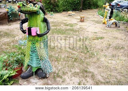 Cartoon character made of secondary raw materials on playground