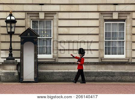London, England, UK - April 25, 2010: The Queen's Guard on duty at Buckingham Palace, the official residence of the Queen of England