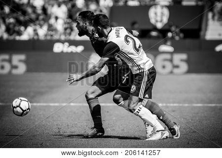 VALENCIA, SPAIN - SEPTEMBER 16: (L) Ivi with ball during Spanish La Liga match between Levante Ud and Valencia CF at Ciutat de Valencia Stadium on September 16, 2017 in Valencia, Spain