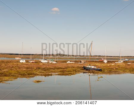 Row Boats Parked In Stream River Estuary In Tollesbury Maldon Essex
