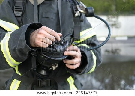 fireman wearing fire fighter turnouts with mask from breathing apparatus, cropped view
