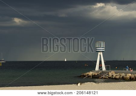 Bellevue Beach near Copenhagen, with round barrel shaped life guard tower