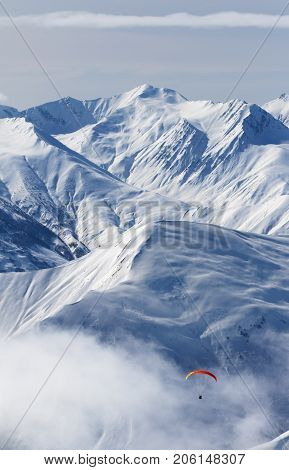 Paragliding At Snow Mountains In Haze