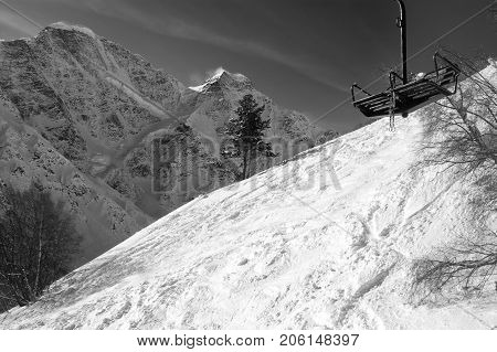 Black And White View On Old Chair Lift And Off-piste Ski Slope