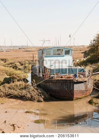 Parked Moored Big Boat In Dock Marshland Front View