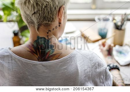 Woman with Tattoo Painting Water Color Art Work Hobby Leisure Rear View