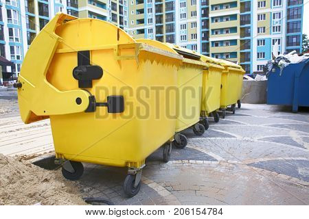 Yellow garbage containers outdoors