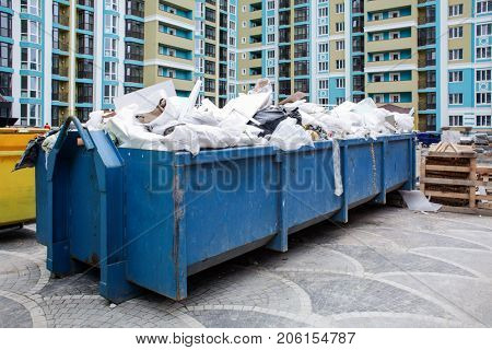 Blue garbage containers outdoors