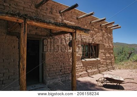 Mud brick house in rural Colorado, on the plains