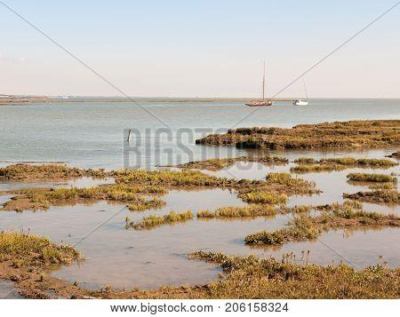 Marshland Coastal Scene Essex Tollesbury Estuary Boats In River Sea