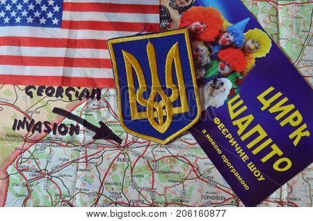 ILLUSTRATIVE EDITORIAL.Ukrainian 911.Georgian invasion.Chevron of Ukrainian army. Poster - FEIR SHOW.Shapito circus (UKR).Kiev,Ukraine.September 11, 2017