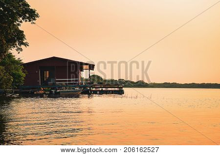 Floating House On The Banks Of A River In Pantanal