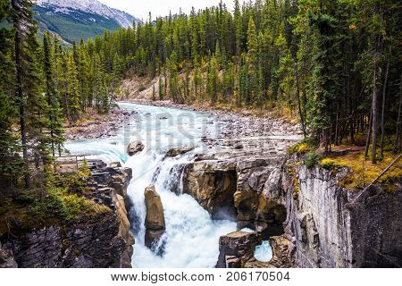 Great Sanvapta Falls in Jasper National Park. Autumn trip to Canada. The concept of extreme and ecological tourism