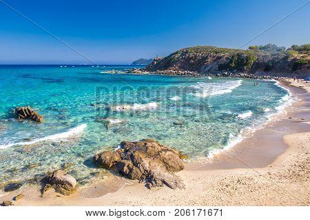 Spaggia di Santa Giusta beach with azure clear water Costa Rei Sardinia Italy. Sardinia is the second largest island in the Mediterranean Sea.
