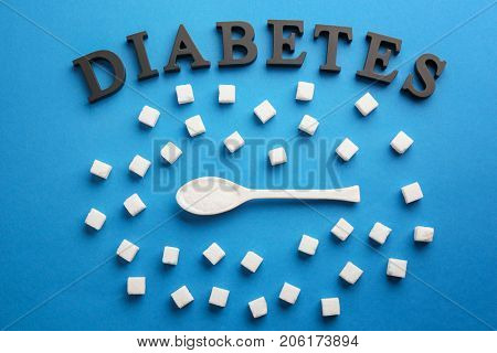 Composition with word Diabetes and sugar on color background