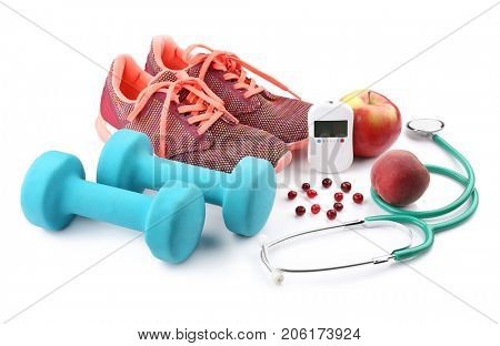 Composition with digital glucometer, stethoscope and sport inventory on white background. Diabetes concept