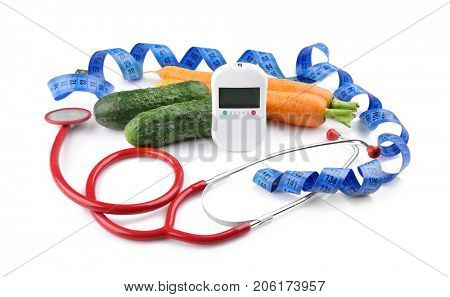 Composition with digital glucometer, stethoscope and fresh vegetables on white background. Diabetes concept