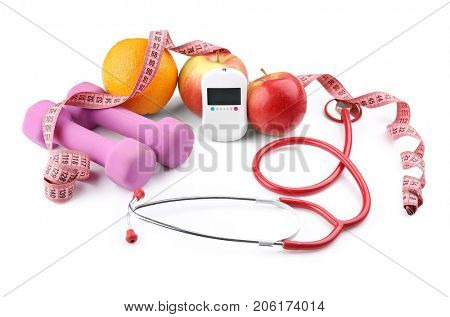 Composition with digital glucometer, stethoscope and dumbbells on white background. Diabetes concept