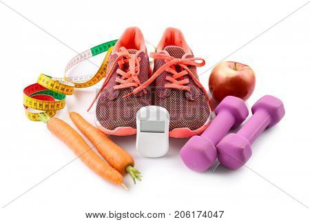Composition with digital glucometer and sport inventory on white background. Diabetes concept