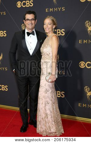 LOS ANGELES - SEP 17:  Ty Burrell, wife at the 69th Primetime Emmy Awards - Arrivals at the Microsoft Theater on September 17, 2017 in Los Angeles, CA