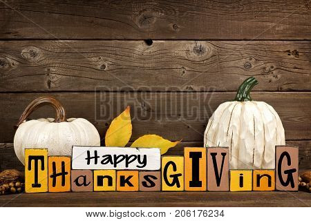 Shabby Chic Happy Thanksgiving Wood Sign With White Pumpkins Against A Rustic Wooden Background