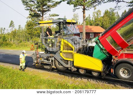 asphalt machines tarmacing small country road