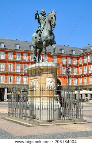 MADRID,SPAIN - AUGUST 7,2017 : The Plaza Mayor, a major landmark in central Madrid with the equestrian statue of Philip III